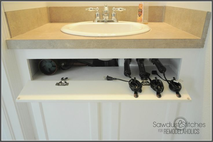 Take back that dead cabinet space by turning the front piece into a tilt-out storage spot. This DIYer keeps her hot tools (and their unruly cords) orderly, thanks to this trick. See more at Remodelaholic »   - CountryLiving.com