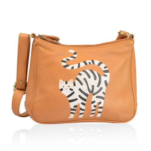 This charming and versatile sling bag made of genuine leather is perfect for everyday use. The tan, white and multi coloured shoulder bag has a hand painted cat design on its exterior that lends it a casual grace. The shoulder bag (Size 30X20.5X8 Cm) comes with adjustable shoulder strap to suit different styles and dresses. The bag has a roomy interior that features inside zippered wall pocket and one multipurpose pocket.