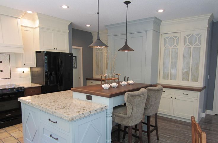 A beautiful kitchen with Cambria quartz  counters (Windermere palette)