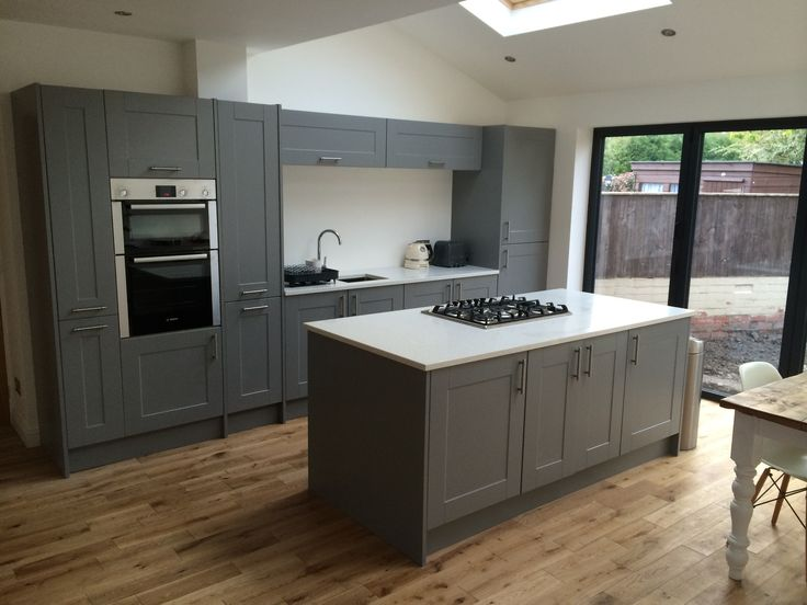 We're in love with the gorgeous Gullwing shade in this Linda Barker Shaker design. Come summer that will be quite the space for entertaining! Bifold doors open up onto what will be a lovely lawn.