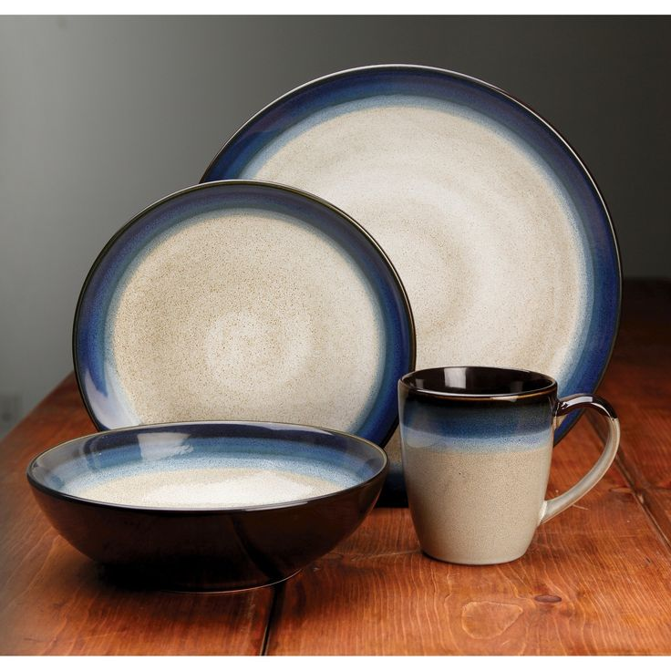 The Gibson Elite Couture Bands 16 Piece Dinnerware Set is a distinct and striking blend of form and function. This durable and elegant stoneware comes in a variety of gorgeous reactive glaze patterns with cream centers and Blue, Brown, or Red Reactive glaze rims. Take your next dining occasion to a higher level of sophistication and beauty with these wonderful and eye-catching pieces. Each set comes complete with 4-each of stunning dinner plates, salad plates, bowls and deep mugs.