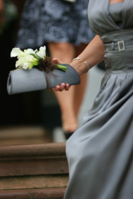 Small corsages can be created and pinned onto the ladies handbags. This is a fun and unique option.