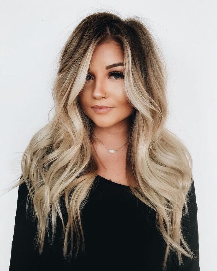 Long blonde hair with relaxed brown roots #blonde