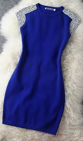 Blue beaded dress, perfect for formal occasions.