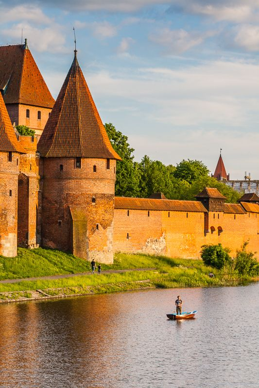 The walls of Malbork Teutonic Castle on the Nogat river, Poland