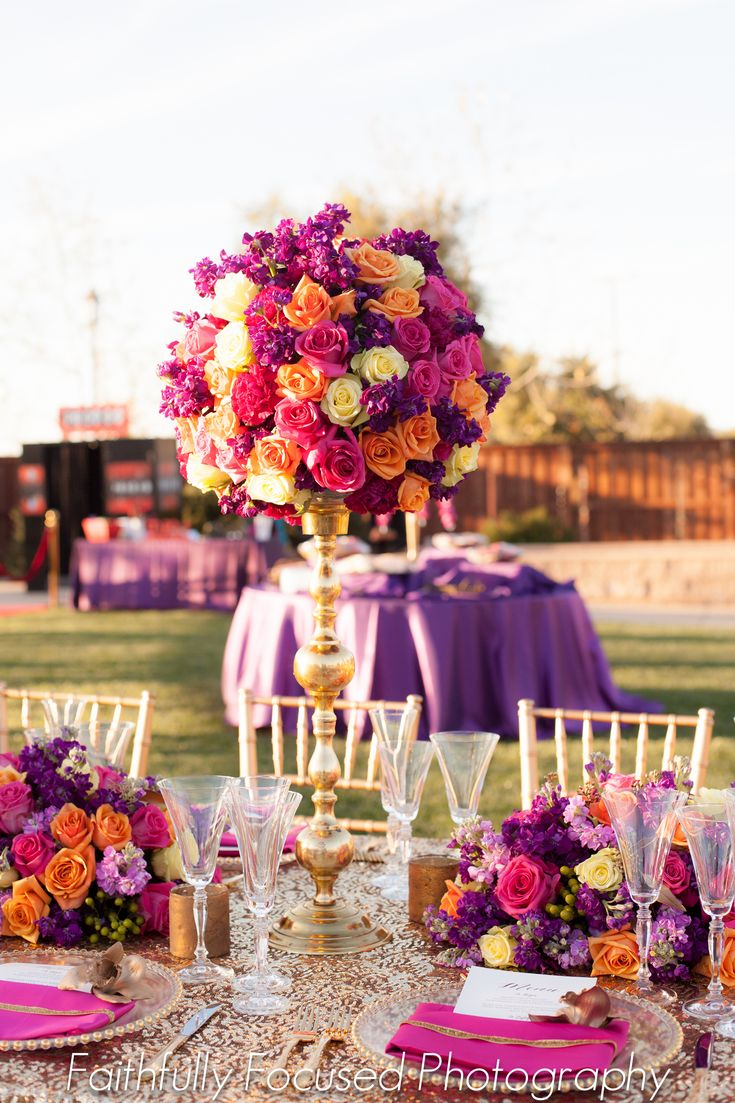 #Bohemian style #wedding #tablescape. Over-the-top and lots of #color! #Purple, #pink, #orange, #green, #yellow, and #gold. #weddings #realweddings #events #eventplanning #decor #tablescape #weddingideas #colorfulweddingideas #flowers #floral