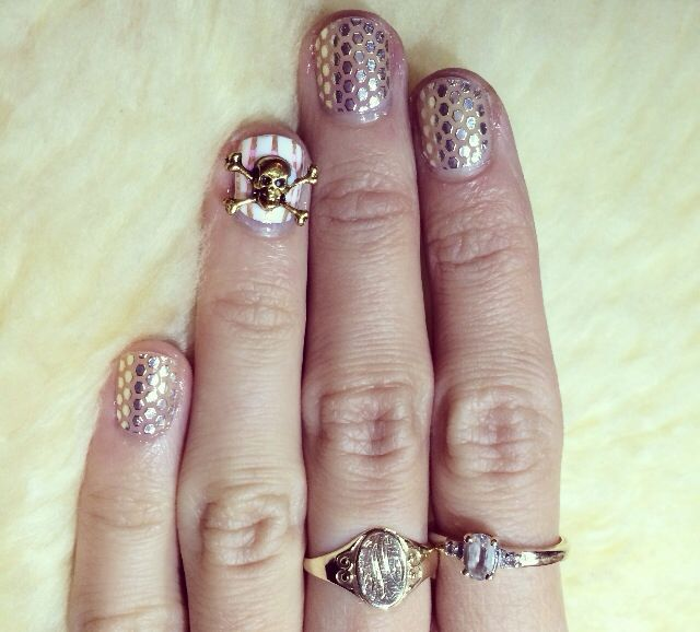 "Love this skull from shop the nail room...used Essie's sleek sticks ""oh my gold"""