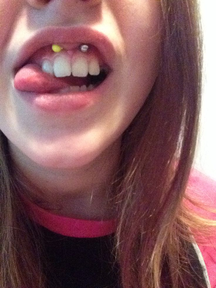 how to put the ball of a piercing on