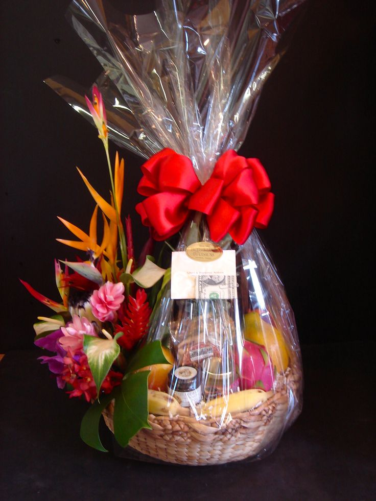 """Tropical Splendor"" a very unique and popular Hawaiian gift basket with half of the basket carrying fresh exotic tropical arrangement, local seasonal fruit, and Hawaiian premium snacks. Price: $180.00"