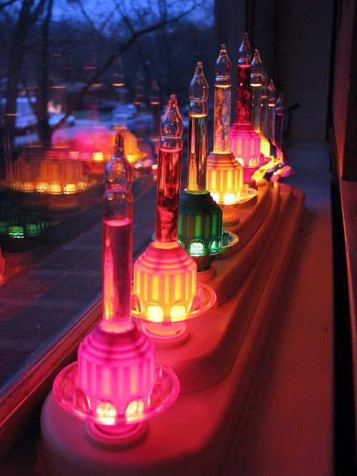 Bubble light window display// love this idea to plug in bubble lights rather than the electric candles in the base. It must look amazing from outside looking in.