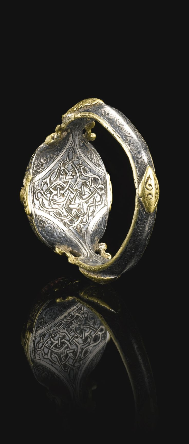A fine and rare Seljuk silver and gold ring set with a deep purple stone seal bearing the name of Ali Ibn Yusuf, Persia, 12th centurySotheby's