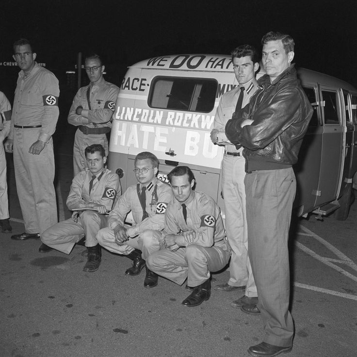 """George Lincoln Rockwell (r), leader of the American Nazi Party, bought a Volkswagen van and turned it into a """"Hate Bus"""" by plastering swastikas and pro-white slogans all over it, when the Freedom Riders began their journey to desegregate bus stations in the deep South. [The photo was taken on May 23rd, three days after the Freedom Riders were assaulted at the Greyhound Bus Station in Montgomery, Ala.]"""
