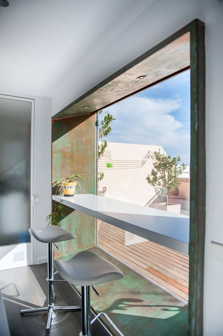 """Renovation of a Bright Penthouse by AreaArquitectura.Design The oxidized copper gives this a nice """"earthish"""" feel. Not sure about the surrounding bright white but the large window for a coffee and pastry would be very nice.  Really like this"""