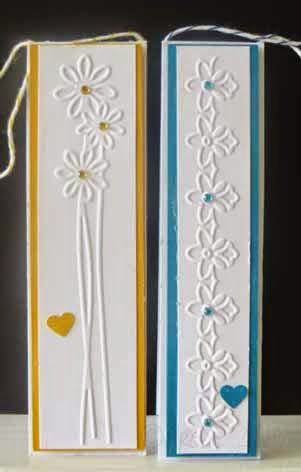 handmade bookmarks/tags from All Occasions Cards, Papers and More ... used scraps from cutting out cards ... border embossing folders used for texture ...