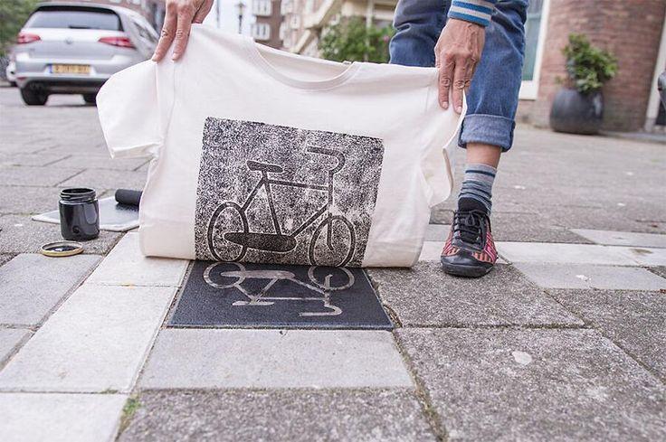 Capi di abbigliamento stampati sui tombini delle città europee