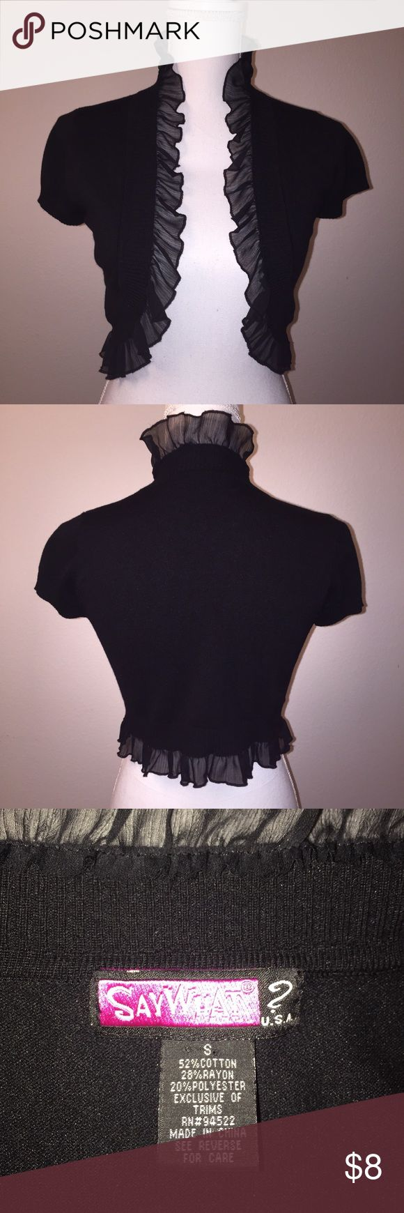 Say What? Black Ruffled Short Sleeve Shrug Sweater This adorable sweater from Say What? features gorgeous chiffon trim and cinched sleeves. It is size S and is in excellent condition. If you have any questions, please ask! Say What? Sweaters Shrugs & Ponchos