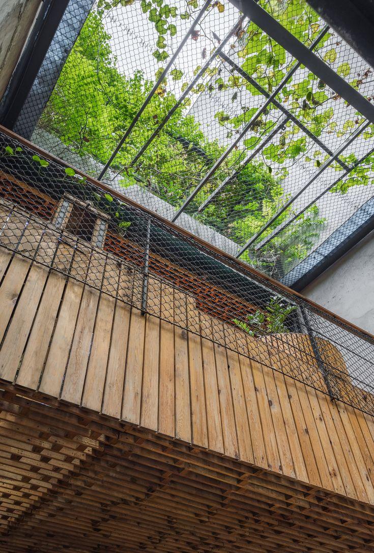 https://www.dezeen.com/2017/11/02/koi-cafe-farming-architects-hanoi-vietnam-fish-pond-indoor-waterfall-farm-aquaponics-trees-vegeatables-tiles/
