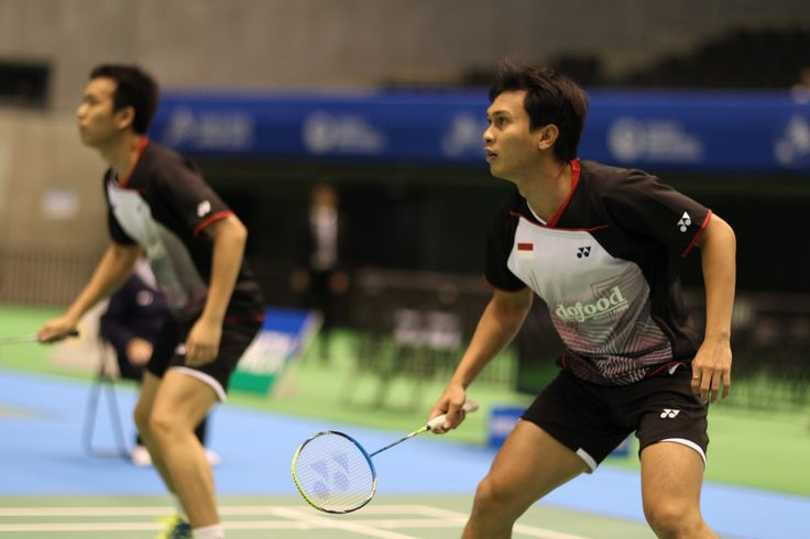 Doubles players Hendra Setiawan (NANORAY 800) & Mohammad Ahsan (ARCSABER FB) compete in the YONEX OPEN JAPAN 2013