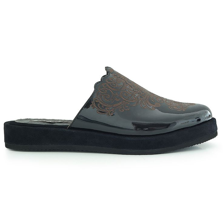 Flat clogsinspired by Islamic art. Made from natural black leather…