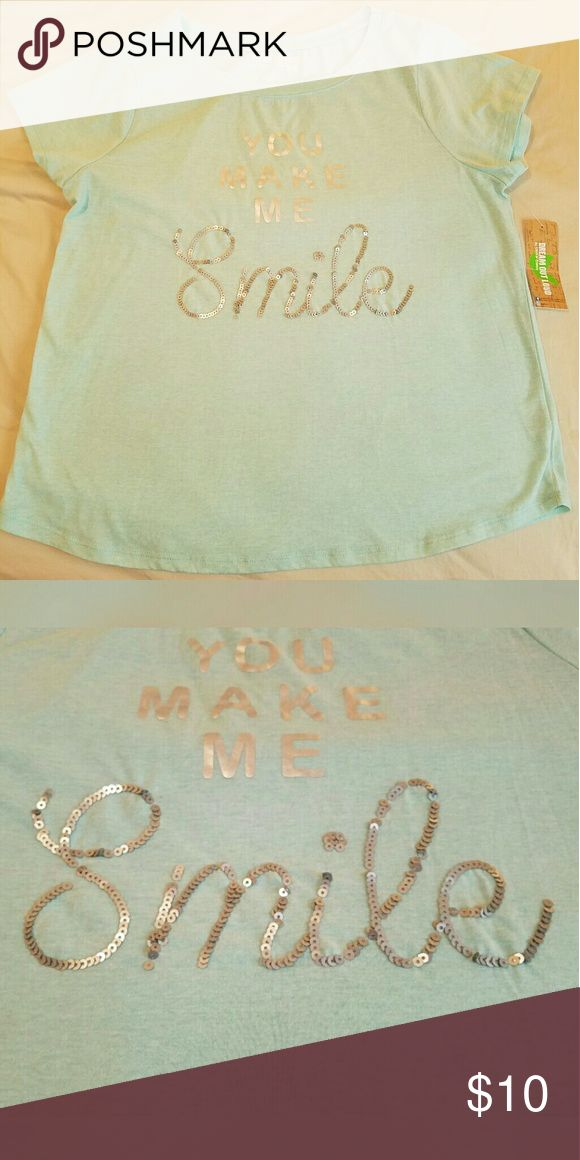 NWT You Make Me Smile top You Make Me Smile Top from Selena Gomez' Dream Out Loud clothing line. Brand new, never worn and has the tag still on so it's in great condition. The word smile is made up of sequins, the rest of the words are silver. I am willing to accept any reasonable offer! ^.^ Tops Tees - Short Sleeve