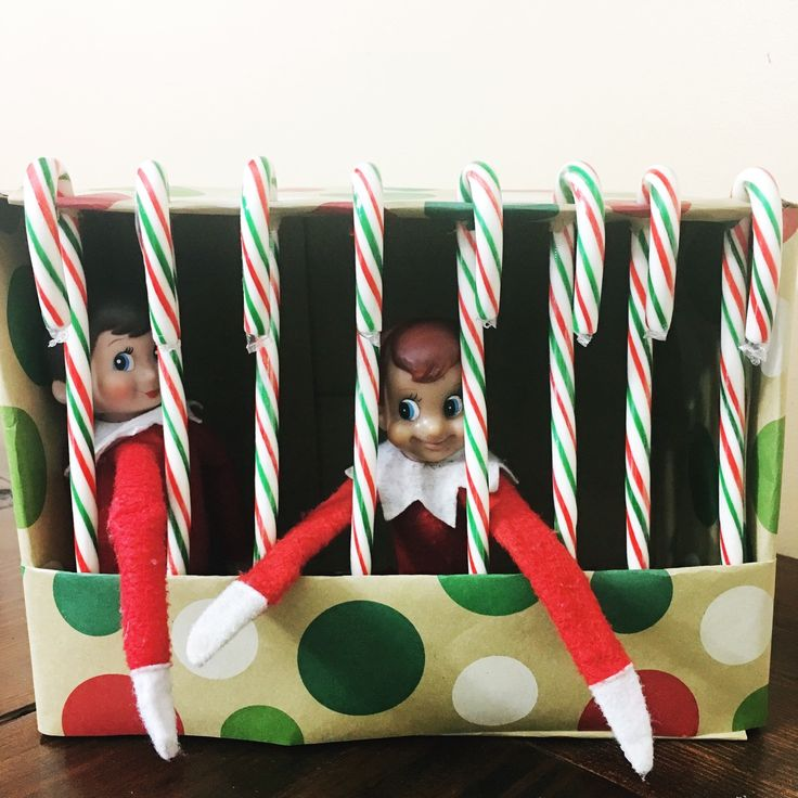 This candy cane jail is fun idea for the elf on the shelf. Learn how to make the candy cane jail and download your free elf jail printables.