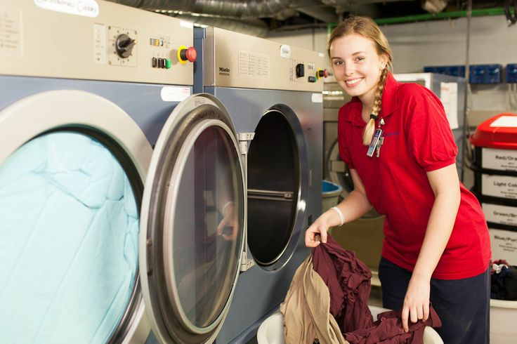 Alicia Sinclair (Canada) washes clothes in the laundry.