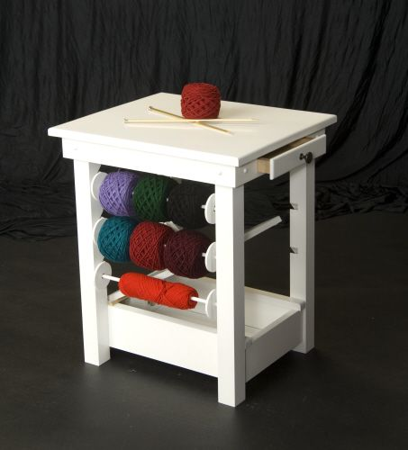 Solid Wood - White Finish Knitting / Crochet Table  Great design; reasonable price.  But...where do you put your WIPs?  To customize: add some sort of cubby thingy on top (or attached to the wall above) and use some kind of cable management or screw hooks so yarn for different projects doesn't get tangled when you put a project away or take it out.  Also, attach a wall mount file folder organizer on the front (or back) to hold your patterns.  Or adapt an old nightstand or end table.