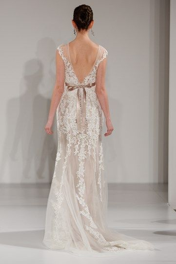 Another Maggie Sottero design, the cascading embroidery draws the eye down toward the dress' train. We love the sweet bow.