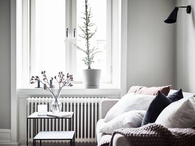 Linen cushions in a beautiful Swedish studio where a little goes a long way