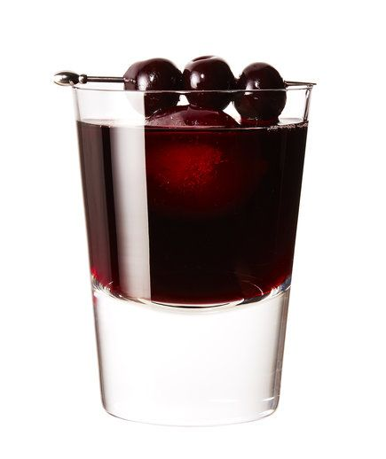 Cherry Manhattan | There's not a smidge of whiskey in the recipe—but there's certainly nothing childish about this sexy, smoky, tea- and black-cherry infused riff on the Manhattan. For maximum effect, garnish it with real Maraschino cherries, like those sold under the Luxardo name.