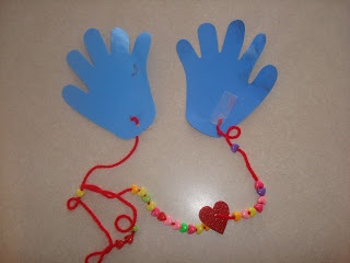 "Kindness Craft.  Mail a ""hug"" to someone who needs it and work on fine motor skills (stringing beads).  Too fun!"