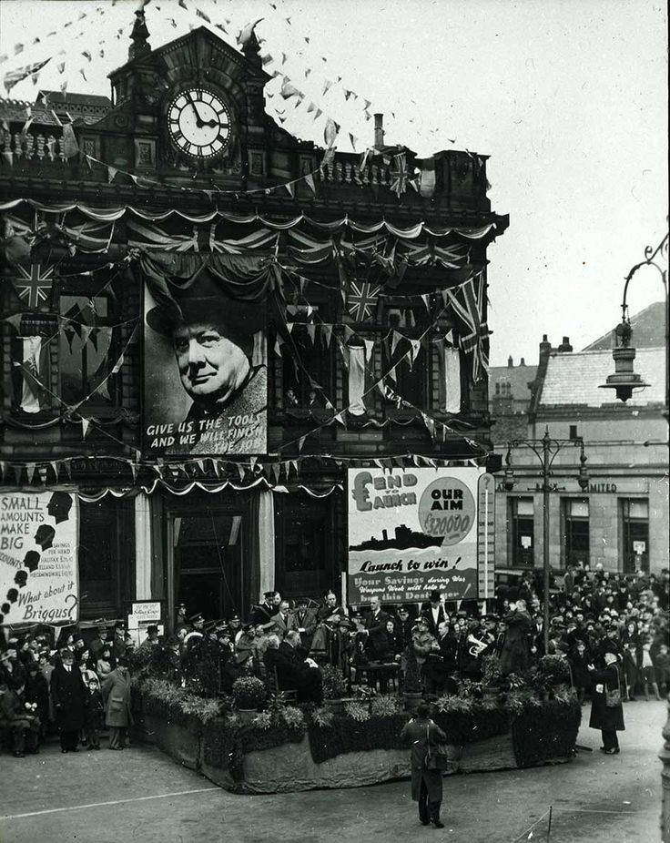 In 1941, Leach made a large donation to the War Effort. Here is a scene from a rally in Brighouse. Eric Leach can be seen somewhere in the crowd. Leach also produced the large print of Churchill.