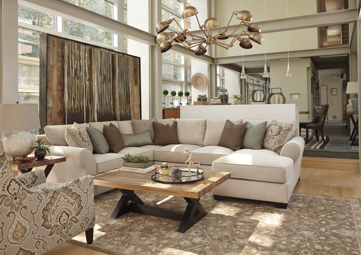The Ashley HomeStore Wilcot Sectional Is Perfect For Those Who Want A Lighter Color Palette In White Living RoomsLiving