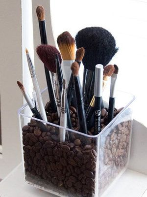 makeup brush holder: glass vase, coffee beans
