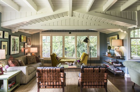"""The chairs are by Casa Midy, and we liked that they have pretty backs since you see them from the entry,"" says Reath Design founder Frances Merrill of this Hollywood Hills craftsman home. ""But everyone's favorite piece is the mustard yellow daybed that we designed for the space."