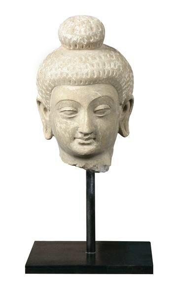 Head of Buddha, Gandhara, 2nd - 3rd Century. Stucco. Height: 6 in.