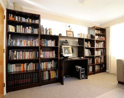 seamlessly combining work station with bookshelves - Living Room, Wellington