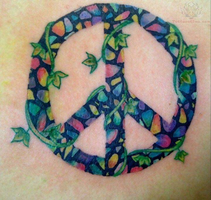 Mosaic peace sign tattoo