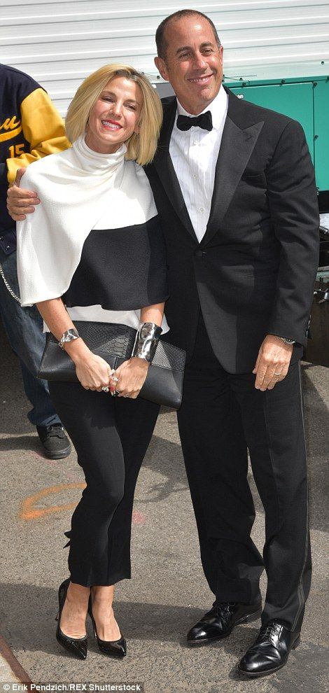 Ready for their close-ups: Jerry Seinfeld and his wife Jessica pose outside the Ed Sulliva...