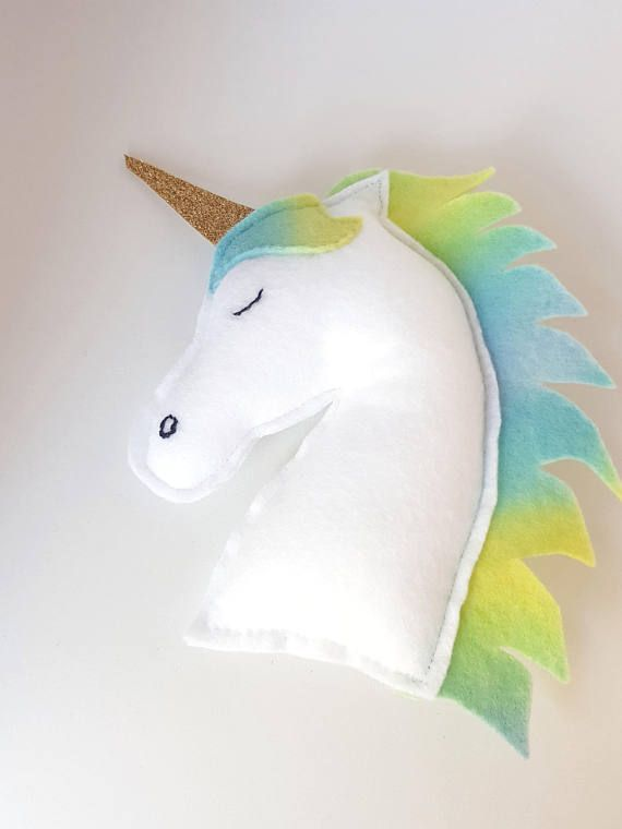 Pretty Unicorn Plush Toy Made from beautiful soft felt and lightly stuffed. With a gold sparkling horn. Can be a toy, décor item, unique gift. Measure between 16cm (6.29 inches) x 13cm (5.11 inches) Horn is 5.5cm (2.16 inches) Perfect for Unicorn Collectors! *Please note: Because ALL Hello Little Life items are one-of-a-kind, made by hand, some may have slight differences or variations from the photographs.