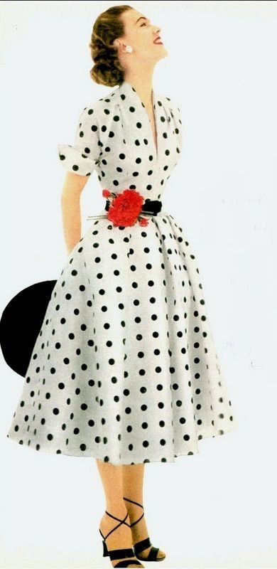 1952 Model in white and black polka-dotted dress of silk shantung by Donald Dress, Glamour, May