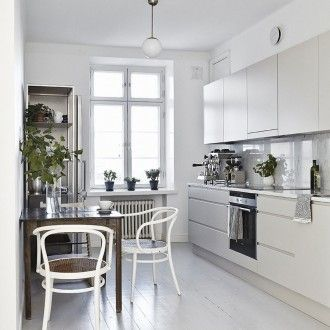 Apartment : Charming Scandinavian Apartment Interior Design In Helsinki, Finland - Lovely Apartment Kitchen In Helsinki, Finland with Scandinavian Design Style showing Modern Beige Cabinets and White Quartz Countertops and Tiled Backsplash also Mini Rustic Dining Table and White Chairs and Wood Flooring and Natural Nuance from The Indoor Plants Decorations thumbnail version