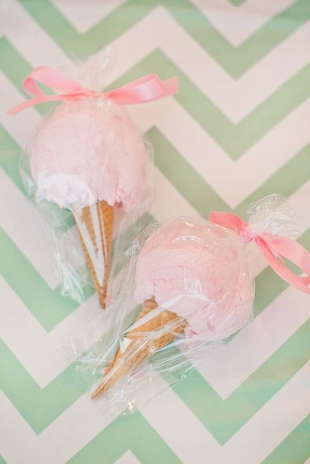 Ice cream cones filled with cotton cotton tied up with pink ribbon! Such a sweet idea for a party! #partydecor #partyfavor