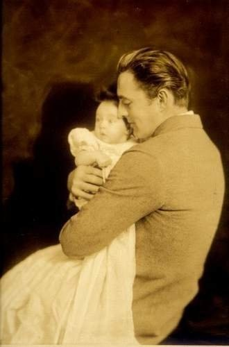 Here is John Barrymore a new dad, who was a famous Irish American actor and related to Drew Barrymore.  In this picture, he cherishes his new born infant