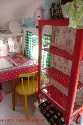 Love this red cabinet with chicken wire and see the floral fabric back. What a great idea