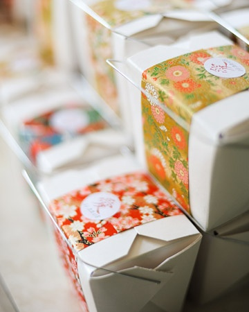 """The Favors  Simple take-out containers were wrapped with Japanese """"washi"""" paper from Paper-Source.com and secured using stickers designed by the bride that feature the Japanese kanji character for """"love."""" The couple filled the boxes with candy and added a note thanking each guest for being a part of their day"""