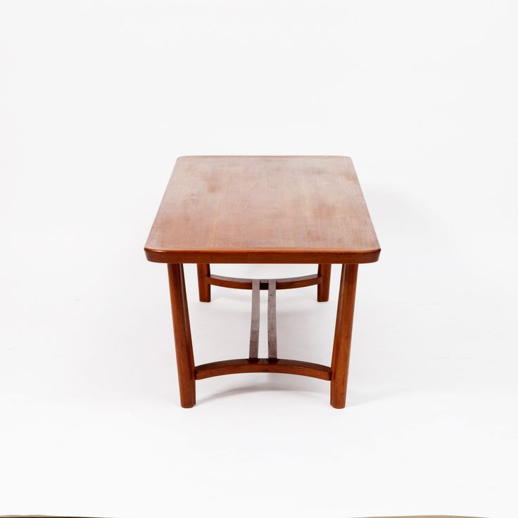 Circa 1950  Impressive in size, this mid century Scandinavian sofa table is also elegant in its simplicity, with an organically shaped teak structure in mint vintage condition.  SIZE  Width: 70 cm  Length: 170 cm  Height: 55 cm
