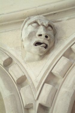 Grotesque on the The Temple Church, late-12th-century, London located between Fleet Street and the River Thames, built for and by the Knights Templar as their English headquarters.