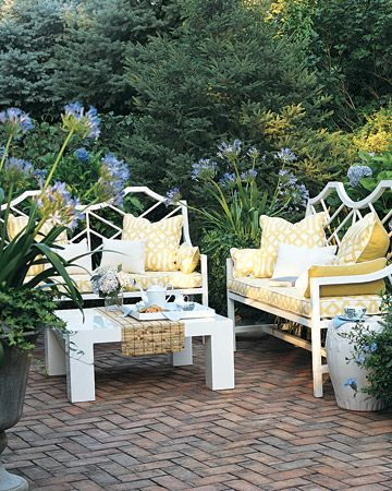 white painted furniture, covered cushions, pot plants