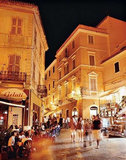 The passeggiata, the ritual promenade of summer, has many distractions for all ages in La Maddalena, Sardinia.